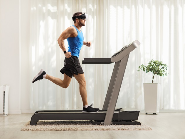 Man exercising on a treadmill at home